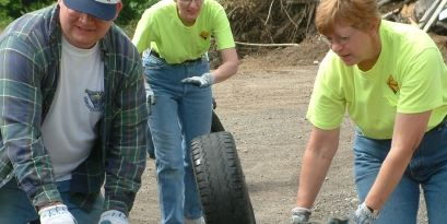 Picture of people rolling old tires