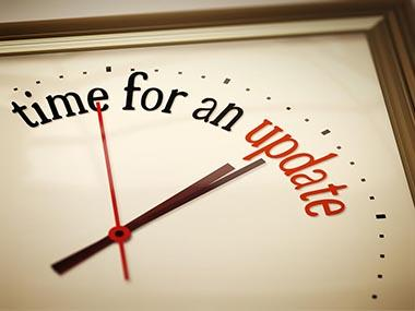 Analog clock image with the words &#34time for an update&#34.