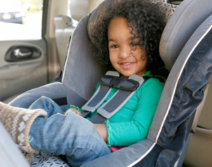 Little Girl sitting in Car Seat